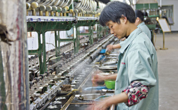 CLOTHES THE SALE A worker detaches silk from cocoons in Suzhou, China. American garment makers transacting silk purchases in renminbi are one example of U.S. producers that could save money by settling in the Chinese currency.